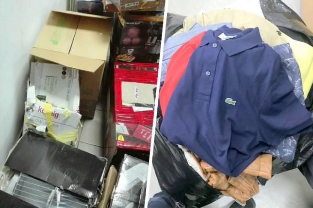 Zaplenjena veća količina firmirane garderobe, električnih aparata i alata